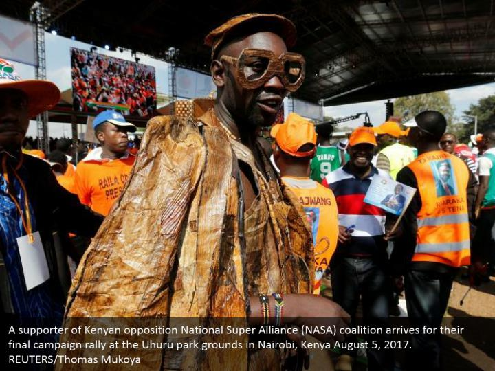 A supporter of Kenyan opposition National Super Alliance (NASA) coalition arrives for their final campaign rally at the Uhuru park grounds in Nairobi, Kenya August 5, 2017. REUTERS/Thomas Mukoya
