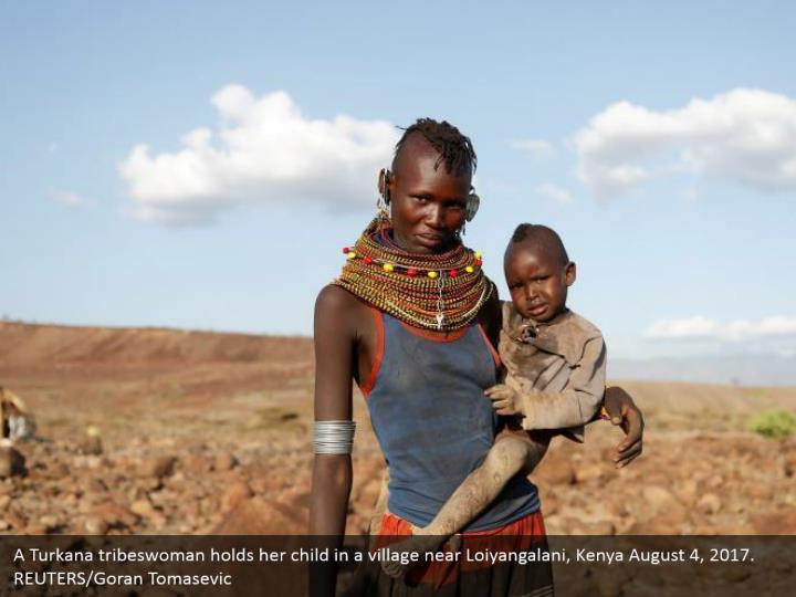 A Turkana tribeswoman holds her child in a village near Loiyangalani, Kenya August 4, 2017. REUTERS/Goran Tomasevic