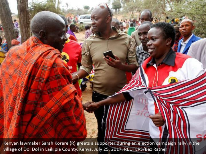 Kenyan lawmaker Sarah Korere (R) greets a supporter during an election campaign rally in the village of Dol Dol in Laikipia County, Kenya, July 25, 2017. REUTERS/Baz Ratner