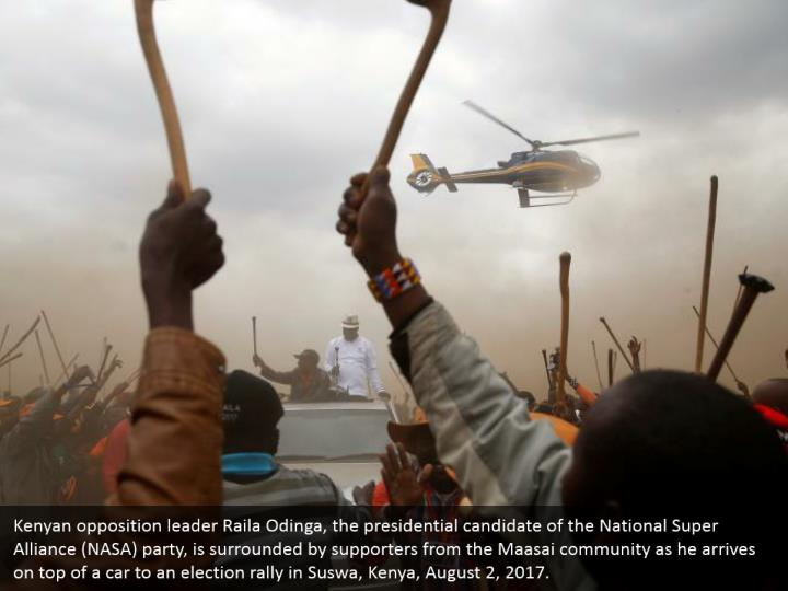 Kenyan opposition leader Raila Odinga, the presidential candidate of the National Super Alliance (NASA) party, is surrounded by supporters from the Maasai community as he arrives on top of a car to an election rally in Suswa, Kenya, August 2, 2017.