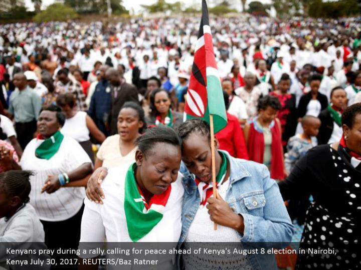Kenyans pray during a rally calling for peace ahead of Kenya's August 8 election in Nairobi, Kenya July 30, 2017. REUTERS/Baz Ratner