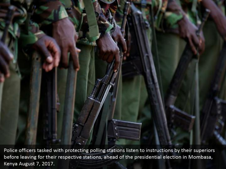 Police officers tasked with protecting polling stations listen to instructions by their superiors before leaving for their respective stations, ahead of the presidential election in Mombasa, Kenya August 7, 2017.