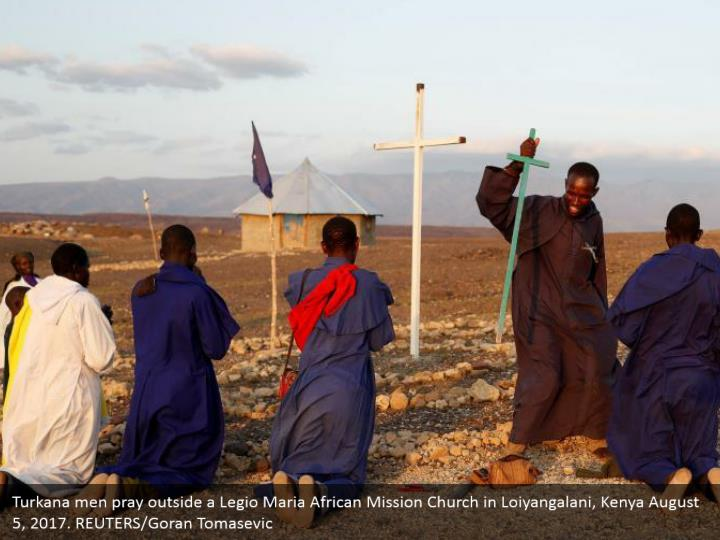 Turkana men pray outside a Legio Maria African Mission Church in Loiyangalani, Kenya August 5, 2017. REUTERS/Goran Tomasevic