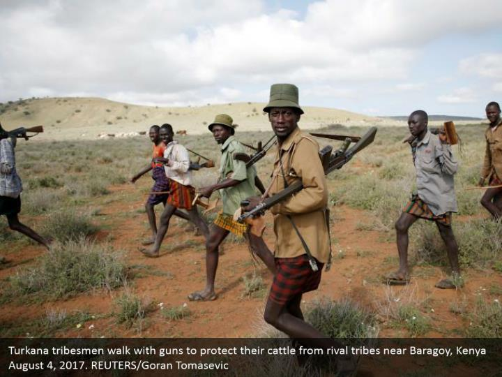 Turkana tribesmen walk with guns to protect their cattle from rival tribes near Baragoy, Kenya August 4, 2017. REUTERS/Goran Tomasevic