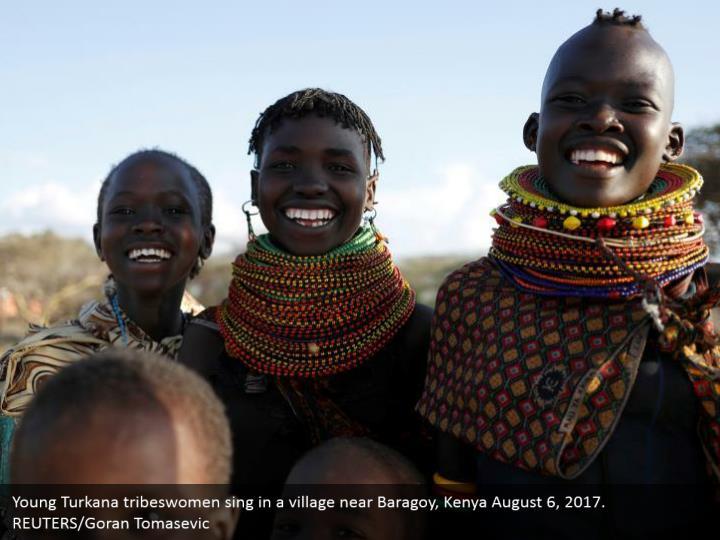 Young Turkana tribeswomen sing in a village near Baragoy, Kenya August 6, 2017. REUTERS/Goran Tomasevic