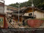 a man walks through the debris of a building that