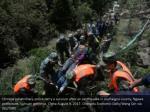 chinese paramilitary police carry a survivor