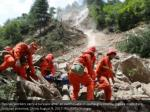 rescue workers carry a survivor after