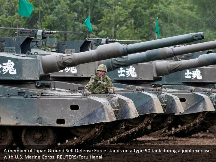 A member of Japan Ground Self Defense Force stands on a type 90 tank during a joint exercise with U.S. Marine Corps. REUTERS/Toru Hanai