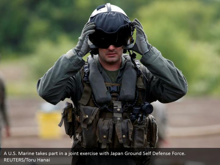 A U.S. Marine takes part in a joint exercise with Japan Ground Self Defense Force. REUTERS/Toru Hanai
