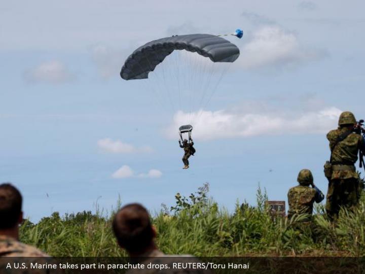 A U.S. Marine takes part in parachute drops. REUTERS/Toru Hanai