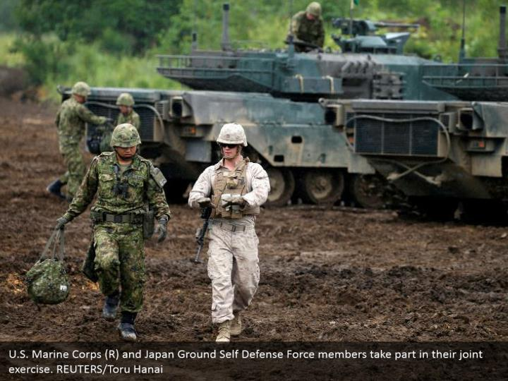 U.S. Marine Corps (R) and Japan Ground Self Defense Force members take part in their joint exercise. REUTERS/Toru Hanai