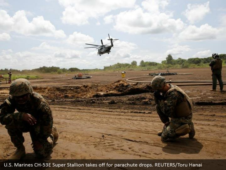 U.S. Marines CH-53E Super Stallion takes off for parachute drops. REUTERS/Toru Hanai