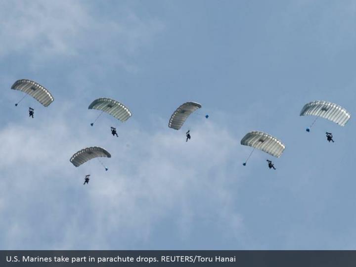 U.S. Marines take part in parachute drops. REUTERS/Toru Hanai
