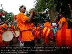 hindu devotees play musical instruments as they