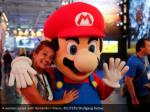 a woman poses with nintendo s mario reuters