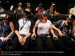 gamers enjoy a virtual ride in a roller coaster