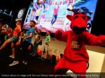 visitors dance on stage with the just dance video
