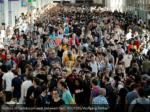 visitors of gamescom walk between halls reuters