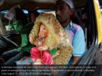 a devotee transports an idol of the hindu