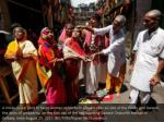 a hindu priest 2nd r helps women to perform