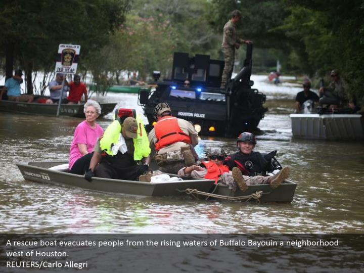 A rescue boat evacuates people from the rising