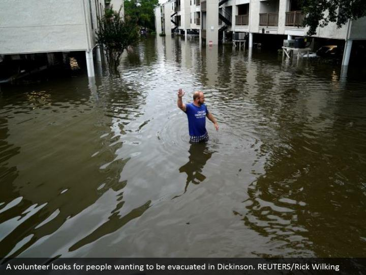 A volunteer looks for people wanting to be evacuated in Dickinson. REUTERS/Rick Wilking