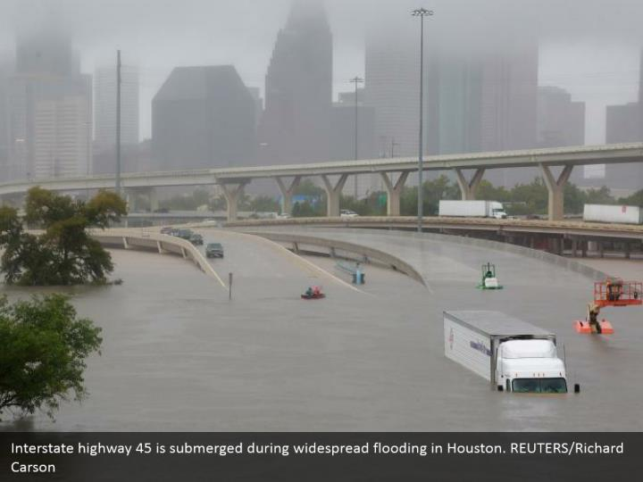 Interstate highway 45 is submerged during widespread flooding in Houston. REUTERS/Richard Carson