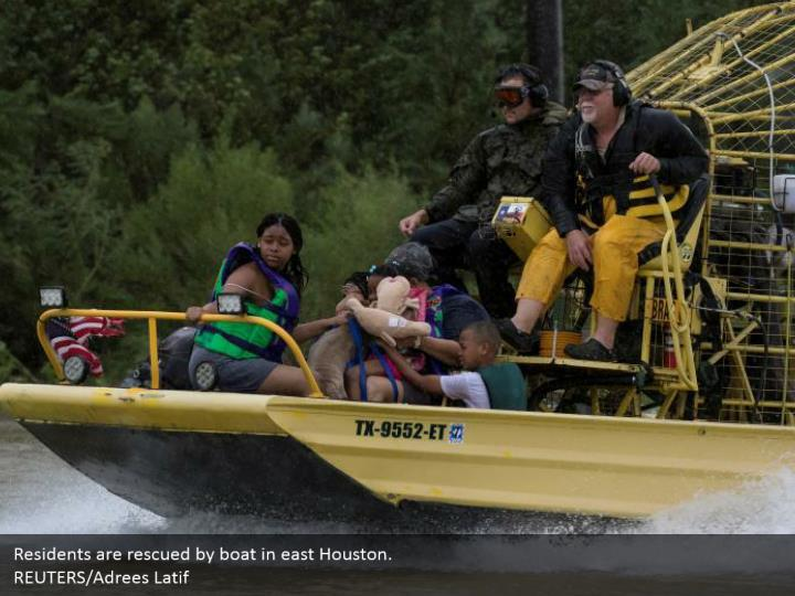 Residents are rescued by boat in east Houston.  REUTERS/Adrees Latif