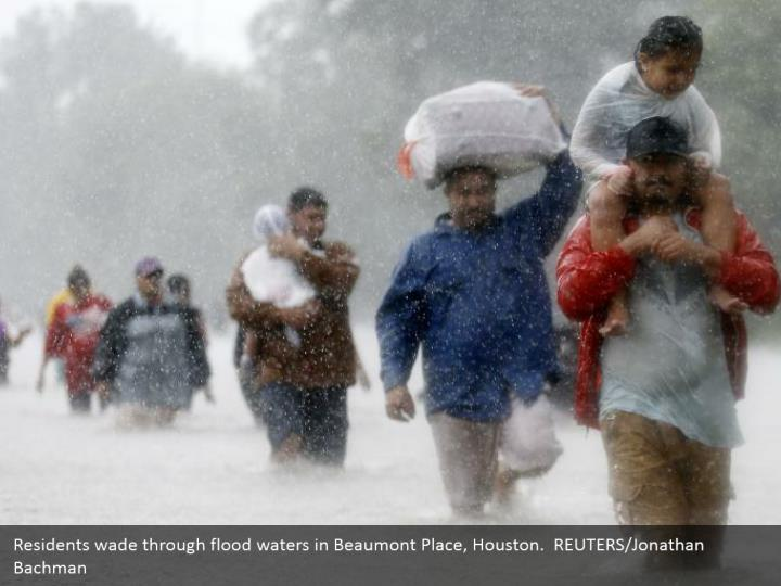 Residents wade through flood waters in Beaumont Place, Houston.  REUTERS/Jonathan Bachman
