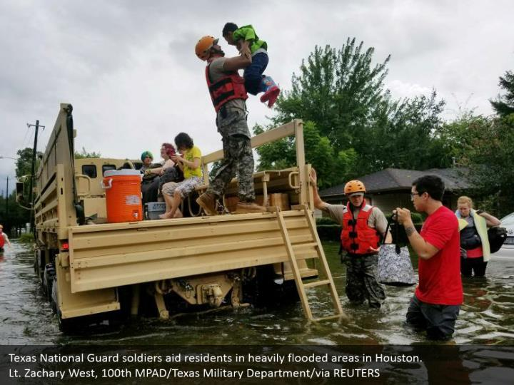 Texas National Guard soldiers aid residents in heavily flooded areas in Houston. Lt. Zachary West, 100th MPAD/Texas Military Department/via REUTERS