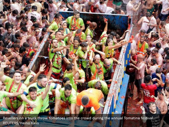 Revellers on a truck throw tomatoes into the crowd during the annual Tomatina festival. REUTERS/Heino Kalis
