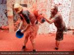 revellers play with tomato pulp during the annual 1