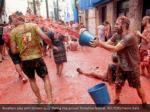 revellers play with tomato pulp during the annual 2