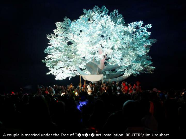 A couple is married under the Tree of T�n�r� art installation. REUTERS/Jim Urquhart