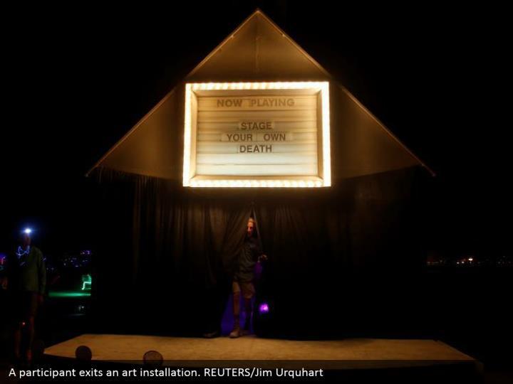 A participant exits an art installation. REUTERS/Jim Urquhart
