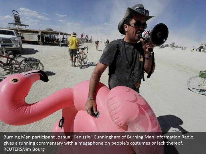 """Burning Man participant Joshua """"Kanizzle"""" Cunningham of Burning Man Information Radio gives a running commentary with a megaphone on people's costumes or lack thereof. REUTERS/Jim Bourg"""