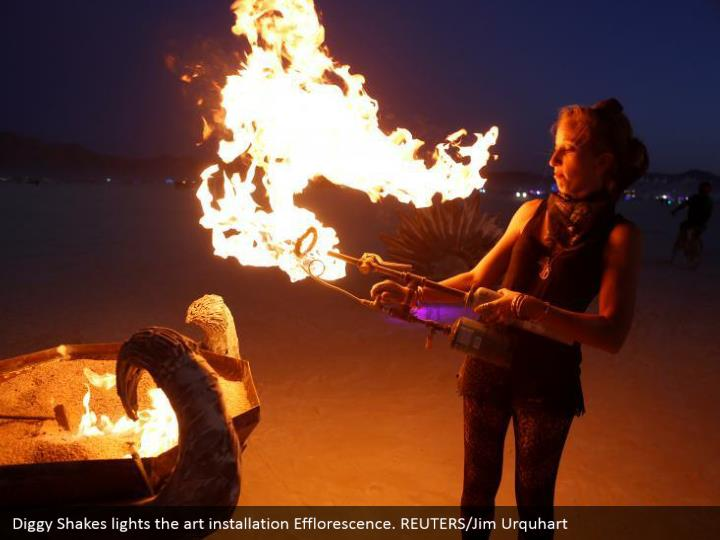 Diggy Shakes lights the art installation Efflorescence. REUTERS/Jim Urquhart