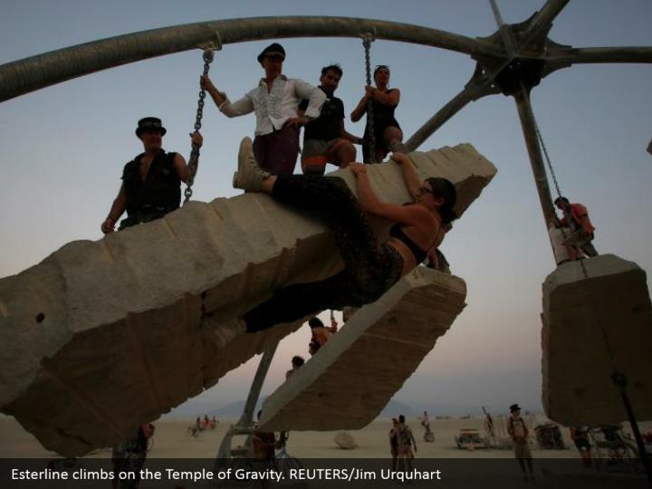 Esterline climbs on the Temple of Gravity. REUTERS/Jim Urquhart