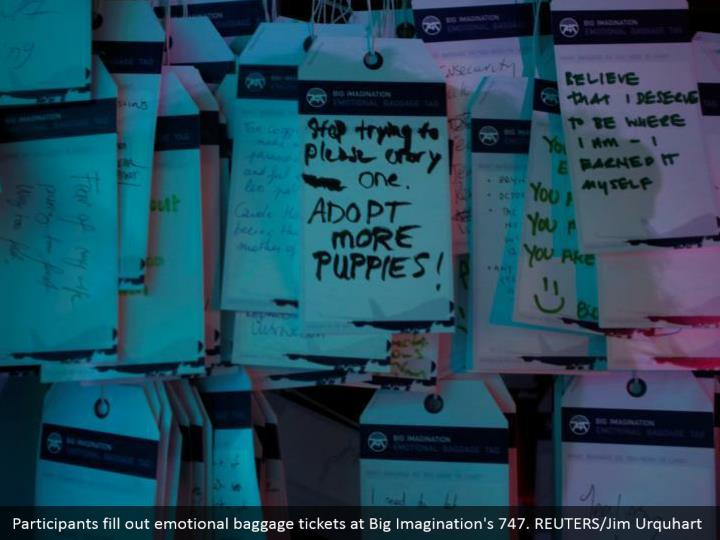 Participants fill out emotional baggage tickets at Big Imagination's 747. REUTERS/Jim Urquhart