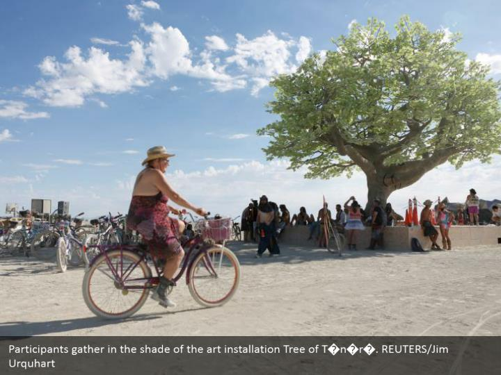 Participants gather in the shade of the art installation Tree of T�n�r�. REUTERS/Jim Urquhart