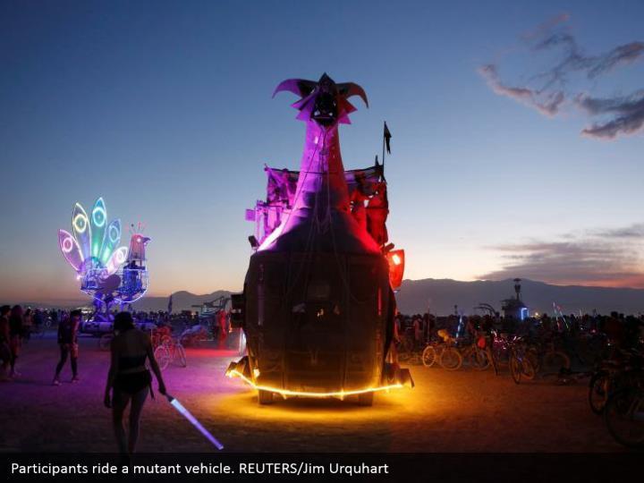 Participants ride a mutant vehicle. REUTERS/Jim Urquhart