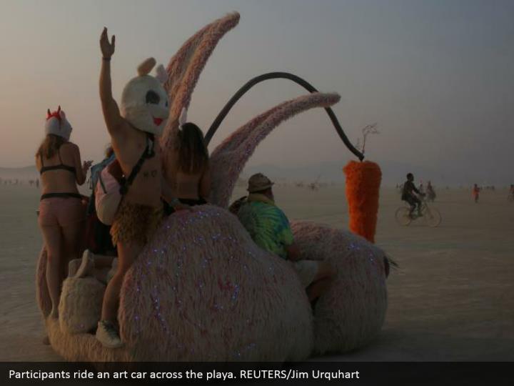 Participants ride an art car across the playa. REUTERS/Jim Urquhart