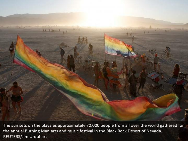 The sun sets on the playa as approximately 70,000 people from all over the world gathered for the annual Burning Man arts and music festival in the Black Rock Desert of Nevada. REUTERS/Jim Urquhart