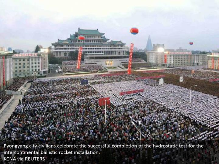 Pyongyang city civilians celebrate the successful completion of the hydrostatic test for the intercontinental ballistic rocket installation.  KCNA via REUTERS