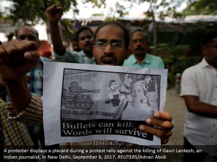 A protester displays a placard during a protest rally against the killing of Gauri Lankesh, an Indian journalist, in New Delhi, September 6, 2017. REUTERS/Adnan Abidi