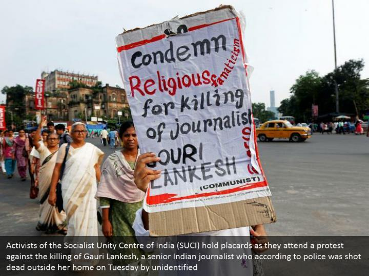 Activists of the Socialist Unity Centre of India (SUCI) hold placards as they attend a protest against the killing of Gauri Lankesh, a senior Indian journalist who according to police was shot dead outside her home on Tuesday by unidentified