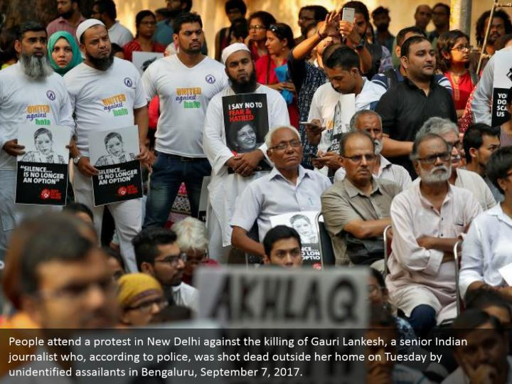 People attend a protest in New Delhi against the killing of Gauri Lankesh, a senior Indian journalist who, according to police, was shot dead outside her home on Tuesday by unidentified assailants in Bengaluru, September 7, 2017.