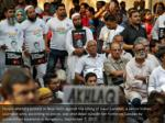 people attend a protest in new delhi against 2
