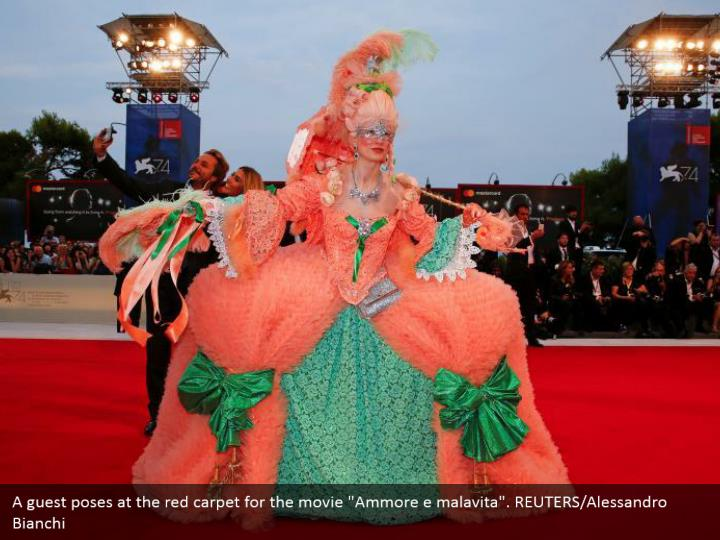 "A guest poses at the red carpet for the movie ""Ammore e malavita"". REUTERS/Alessandro Bianchi"